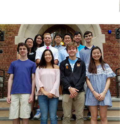 Image of National Merit Semi-Finalists on front stairs of the Manhasset High School.